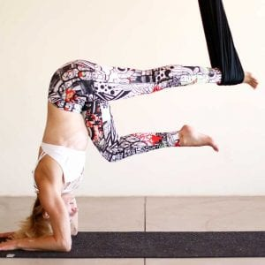handstand in a hammock aireal aerial yoga posture